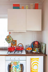 how to decorate space above kitchen cabinets 11 smart ways to use the space above your cabinets kitchn