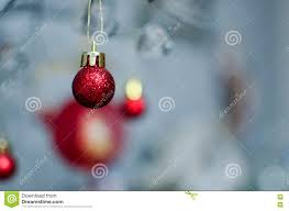 a bobble ornament hanging from a wire stock photo