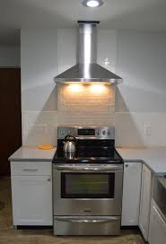 kitchen hood lights light and day loving here