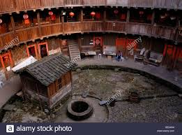 courtyard with a fountain of a tulou round house dirt round