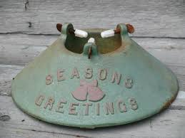 season s greetings cast iron tree stand green and