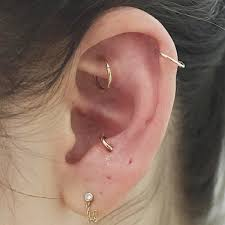 earrings on top of ear nyc piercing trends cool earring combinations photos