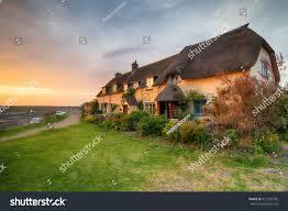 beautiful cottages sunset on porlock weir stock photo 421505785
