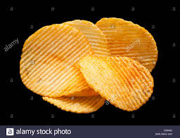 ripple chips potato ripple chips snack isolated on black background stock photo