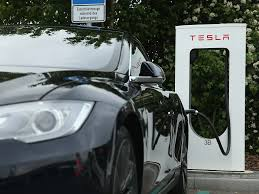 tesla will begin charging for superchargers business insider