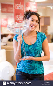 giant cocktail young woman with giant cocktail glass in shop smiling portrait