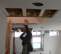 hanging drywall on ceiling one person about ceiling tile