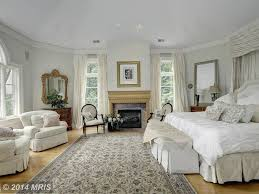traditional master bedroom with high ceiling u0026 crown molding in
