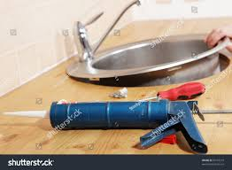 caulking gun silicone sealant against kitchen stock photo 60157519