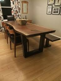 making a live edge table have formal table with full set of chairs extra bench to use when