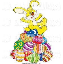 clip art of a cute and happy yellow easter bunny sitting on top of