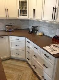 kraftmaid dove white kitchen cabinets kraftmaid gentry maple with dove white cocoa glaze