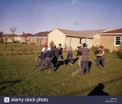 Backyard Football Free 1950s 1960s Group Neighborhood Boys Play Touch Football Backyard