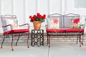 Wrought Iron Outdoor Table Chairs Colorful Wrought Iron Garden Furniture With Vibrant Red Cushions