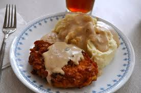 crispy breaded pork chops with milk gravy and meme s mashed