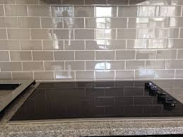 grey glass subway tile backsplash for kitchen and electric stove