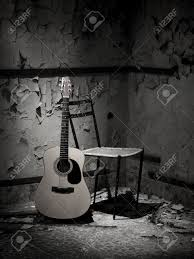 Abandoned Place by Guitar Of A Homeless Man In Grungy Abandoned Place Stock Photo