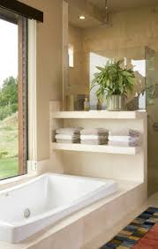neat idea with the use of shelves above the garden tub for towels