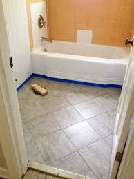 remodelaholic bathroom redo grouted peel and stick floor tiles