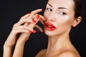 beautiful young with red lips and red nail polish stock photo