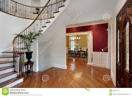 foyer in luxury home with curved staircase stock photo image
