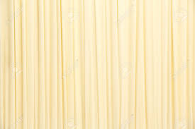 colors close to yellow close up yellow color curtain texture background stock photo