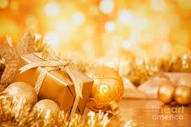 with gold baubles and gift on a gold background