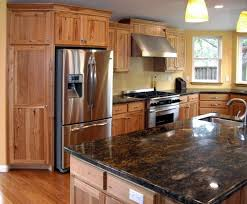image result for focaccia granite with hickory cabinets