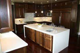 transitional kitchen featuring a beautiful white quartz waterfall