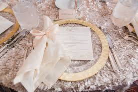 wedding plate reception décor photos gold plate bow around napkin