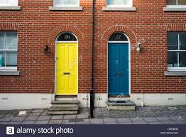 blue and yellow front doors modern houses brighton uk stock