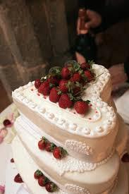 heart shaped wedding cakes ivory three tier heart shaped wedding cake with strawberry decor