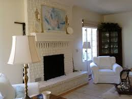 dining table in front of fireplace fireplace chest of drawers and whitewashed brick fireplace in