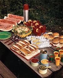 table full of food 1950s picnic table top full of food corn dogs hamburgers