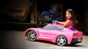 pink corvette power wheels drifting in a pink power wheels corvette