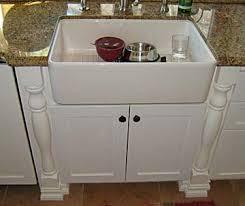 kitchen sink furniture darryn s custom cabinets hand carved corbels toe kick lighting