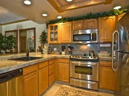 oak cabinets with granite granite and stainless appliances with oak cabinets kitchen color