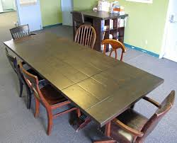 varnished oak wood conference table mixed black acrylic chairs and