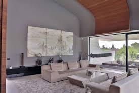 balcony house by a cero several dark cream colored long sofa