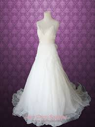 whimsical wedding dress whimsical cross back organza v neck a line lace wedding gown