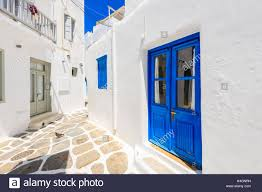 blue door and windows of typical house on street of beautiful