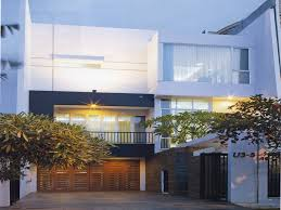 funky modern exterior walls design with wide wooden garage door grey and white wall modern exterior walls design has small yard that can add the modern