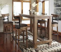 5 piece bar table set with upholstered swivel stools with wood