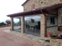 veranda chiusa chiusure per esterni in vetro e pvc vetrate scorrevoli e pieghevoli