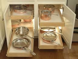 stainless steel cookware sets on small white kitchen corner pantry