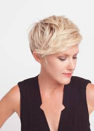 a pixie cut for hair that has some natural wave short on back