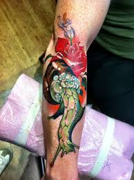 roses arm sleeve tattoo color ink red rose with snail tattoo on arm sleeve