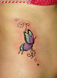 lovely small butterfly with star tattoo on ribs tattoo design ideas
