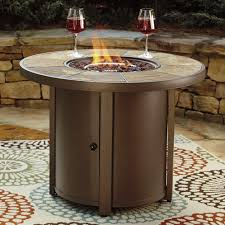 signature design by ashley predmore round fire pit table wayside