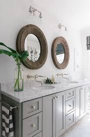 Bathroom Sconces Restoration Hardware Fall U0027s Bathroom Trend Round Mirrors Benjamin Moore Reclaimed